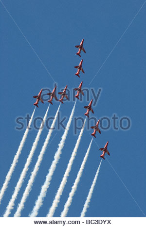 The Royal Air Force 'Red Arrows' display team in formation. - Stock Photo