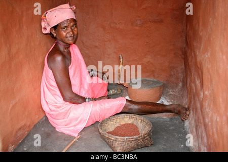 Indian Woman of the Paroja Tribe Grinding Maize, Orissa - Stock Photo