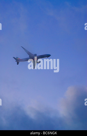 Airliner flying through clouds - Stock Photo