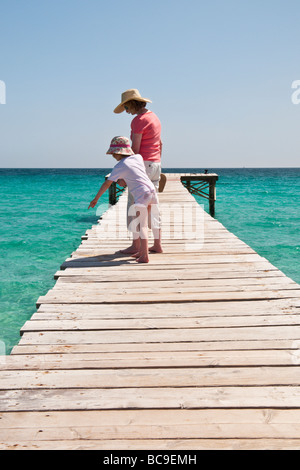 A woman and young girl on a boardwalk near C'an Picafort, Majorca, Spain - Stock Photo