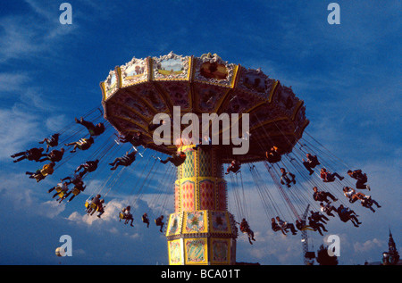 Funfair with people swinging out from rotating carousel Michigan USA - Stockfoto
