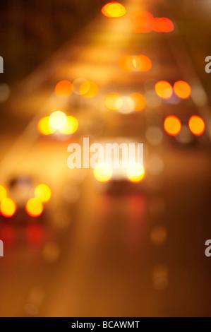 Blurred night freeway traffic - Stockfoto