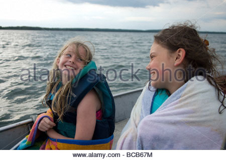 Children go for a boat ride off the shores of Leech Lake in Minnesota. - Stock Photo