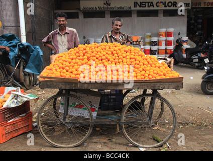 Orange sellers, Trivandrum Market, Kerala, India - Stock Photo