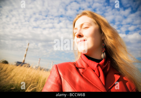 Young woman outdoors portrait Wide angle view - Stock Photo