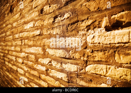 Ancient stone wall Wide angle view and red tint - Stock Photo