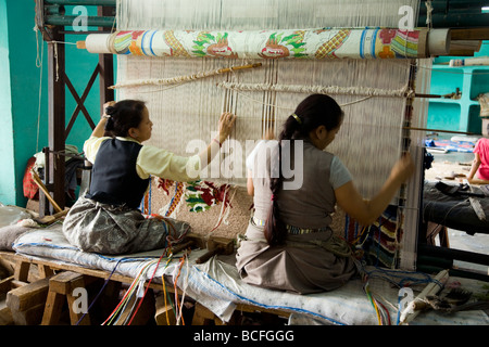 Two Women Work On A Production Line Making Frozen Fish