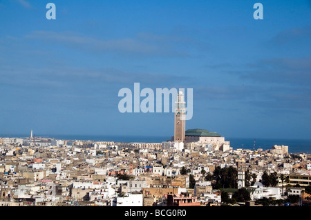 Hassan II Mosque hassan mosque casablanca morocco large rooftop cityscape homes houses condos residences seaside - Stock Photo