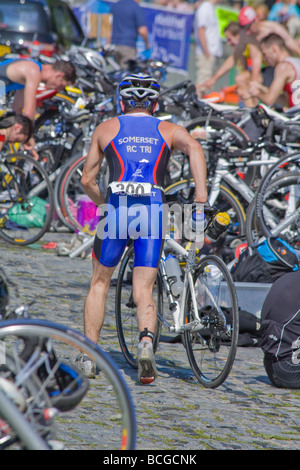 triathlon competitor in the transition area before starting the cycling section - Stock Photo