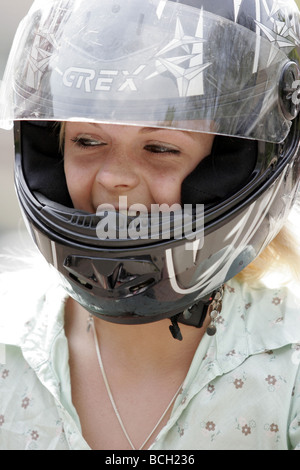 young blonde woman wearing a motorcycle helmet visor. Black Bedroom Furniture Sets. Home Design Ideas