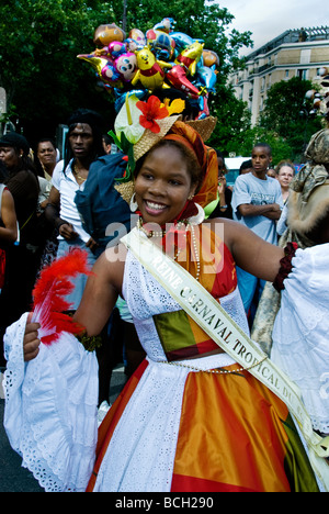 Paris France, Public Events 'Tropical Carnival' Parade 'Carnival Queen' Dancing on Street in Costume French Festivals - Stock Photo