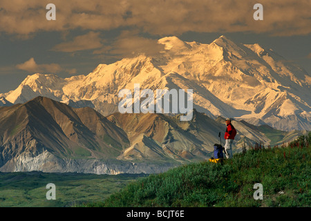 Man Hiking on Tundra w/Mt McKinley Denali NP IN AK Summer - Stock Photo