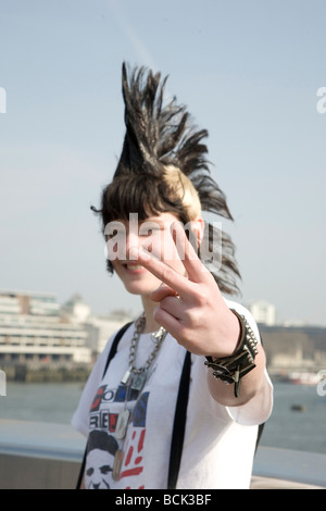 A punk girl 'Rae Ray Riots' with a large Mohican, London Bridge, London, UK 15.3.2009 - Stock Photo