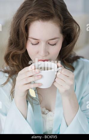 Woman having herbal tea - Stock Photo