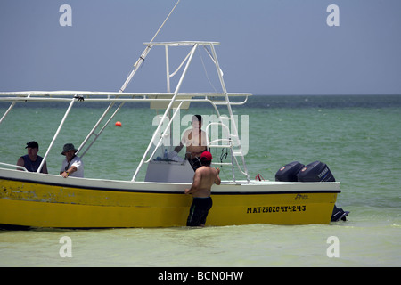 Fishing boat and men in shallow water, Caribbean Sea, Holbox island, Quintana Roo, Yucatán Peninsula, Mexico, - Stock Photo