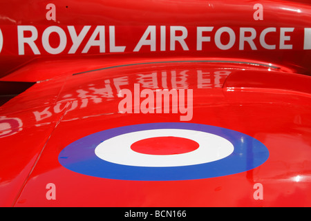 Red, White and Blue RAF 'Royal Air Force' logo on wing of 'Red Arrows' Hawk aircraft, 'close up', UK - Stock Photo