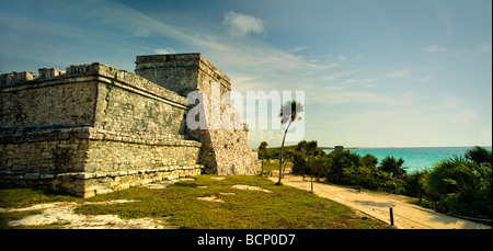 A panoramic image of the main temple structure in the ancient Mayan city at Tulum Mexico - Stock Photo