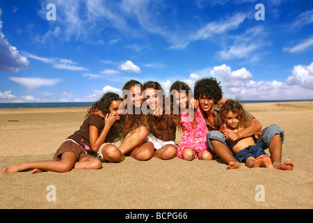 Family of 6 Happy Kids Smiling Outdoors at the Beach - Stock Photo