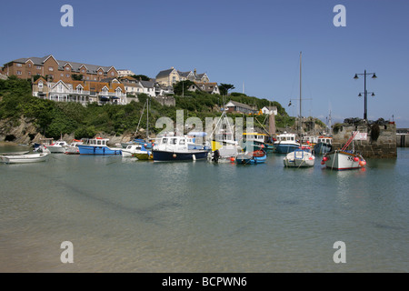 Town of Newquay, England. View of fishing boats moored in Newquay Harbour with North Quay Hill in the background. - Stock Photo