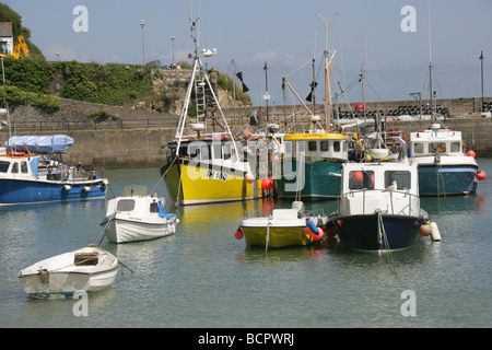 Town of Newquay, England. Scenic view of fishing boats moored in Newquay Harbour. - Stock Photo