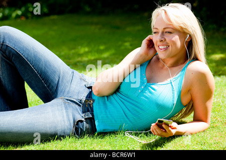 Girl listening to iPod - Stock Photo
