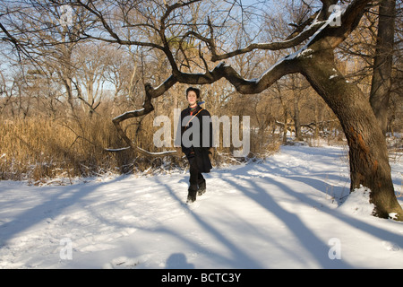 Young woman walking in Prospect Park in Brooklyn New York on a bright winter day MR - Stock Photo