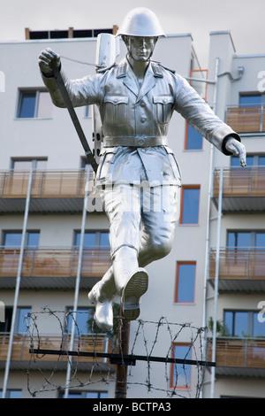 Monument to East German border guard Conrad Schumann, Bernauer Strasse, Berlin, Germany - Stock Photo