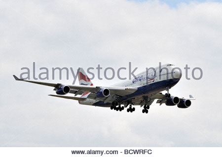 A British Airways Boeing 747 aircraft landing at London's Heathrow Airport - Stock Photo