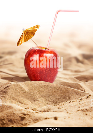 Apple cocktail in a hot desert - Stock Photo