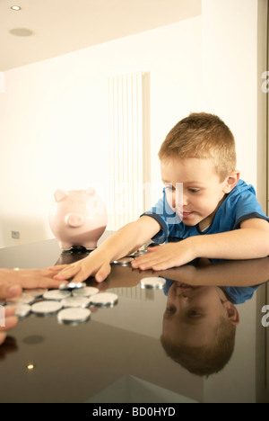 boy grabbing money - Stock Photo