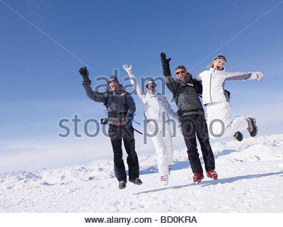 Four people jumping around - Stock Photo