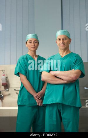 Two medical staff in scrubs - Stock Photo