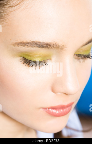 young woman with green eye shadow - Stock Photo