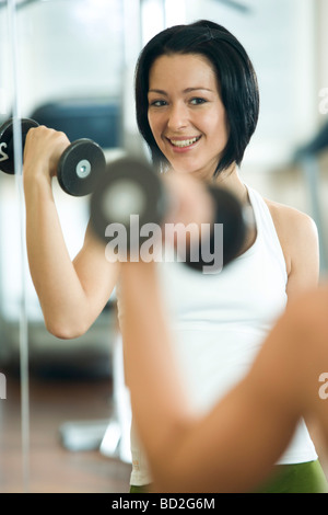 woman exercising in fitness club - Stock Photo