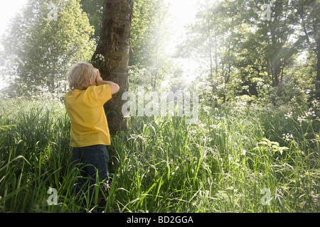 Boy playing hide and seek - Stock Photo