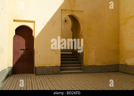 Arch and steps in the interior courtyard of the Mausoleum of Moulay Ismail Meknes Morocco - Stock Photo