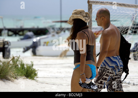 Young couple walking hand in hand on the white sands of Holbox Island, Quintana Roo, Yucatán Peninsula, Mexico, - Stock Photo