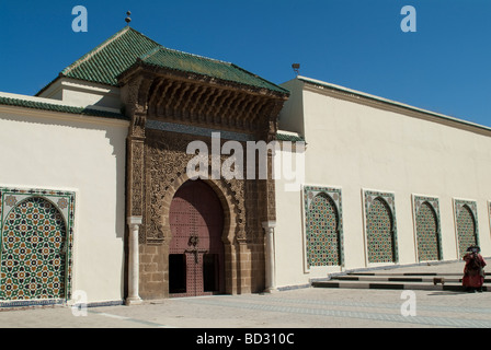 Facade and entrance gate of the Mausoleum of Moulay Ismail Meknes Morocco - Stock Photo