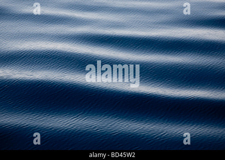 Smooth ripples on the surface of the sea - Stock Photo
