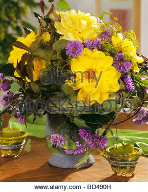 Autumnal arrangement of dahlias, asters and Boston ivy - Stock Photo