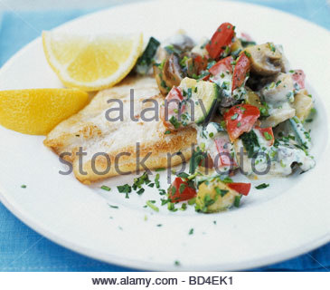 Nile perch fillet on vegetable salad - Stock Photo