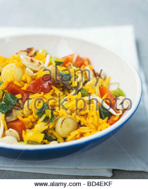 Pan-cooked rice dish with vegetables and sprouts - Stock Photo