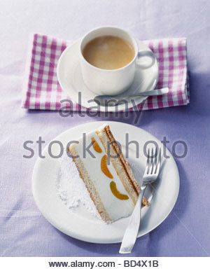 Piece of yoghurt cake with apricots to serve with coffee - Stock Photo