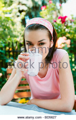 Woman drinking a milkshake - Stock Photo