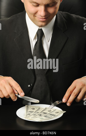 The businessman having dinner dollars Fun on a theme of the finance - Stock Photo