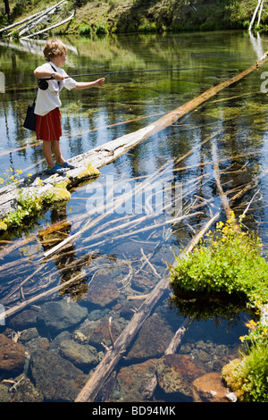 Seven year old boy fly fishing in the Cascades near Bend, Oregon - Stock Photo