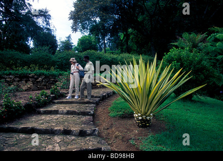 Tourist And Guide Visiting Vumba Botanical Gardens Near