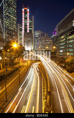 High rise building and car trails at night in Central District, Chung Wan, Hong Kong, China. - Stock Photo