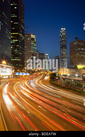 High rise building and car trails at night in Central Hong Kong, China. - Stock Photo