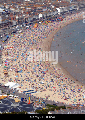 Beach, Weymouth beach, Aerial view of tourists on Weymouth beach during hot weather in Dorset, Britain, UK - Stock Photo